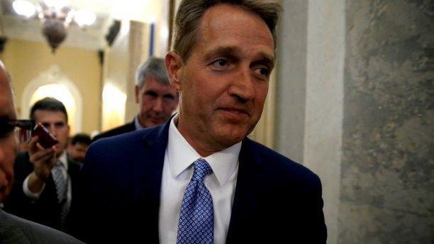 U.S. Senator Jeff Flake (R-AZ) walks past journalists after announcing he will not run for reelection on Capitol Hill in Washington, DC, U.S. October 24, 2017. REUTERS/Joshua Roberts - RC115CA83EE0