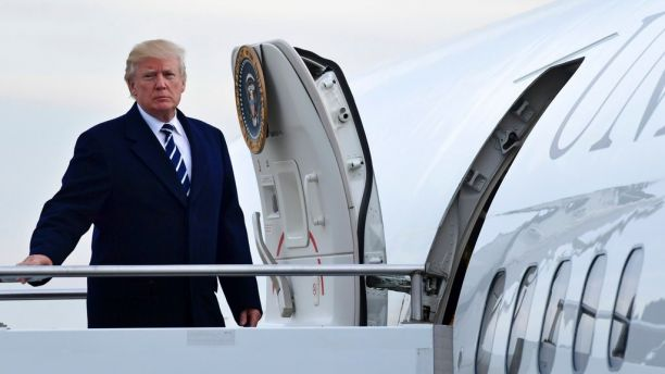 President Donald Trump walks up the steps of Air Force One at John F. Kennedy International Airport in New York, Saturday, Dec. 2, 2017. Trump spent the day in New York attending a trio of fundraisers. (AP Photo/Susan Walsh)