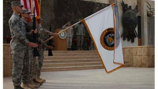 The US Forces Iraq colors are lowered before being encased in a ceremony in Baghdad, Iraq, Thursday, Dec., 15, 2011. The ceremonies mark the official end of the US military mission in Iraq. (AP Photo/Pablo Martinez Monsivais, Pool)