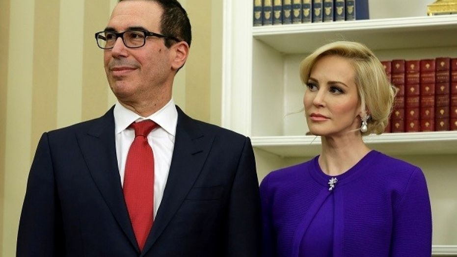Steve Mnuchin and his then-fiancee Louise Linton are seen in the White House before his swearing in as U.S. treasury secretary, Feb. 13, 2017.