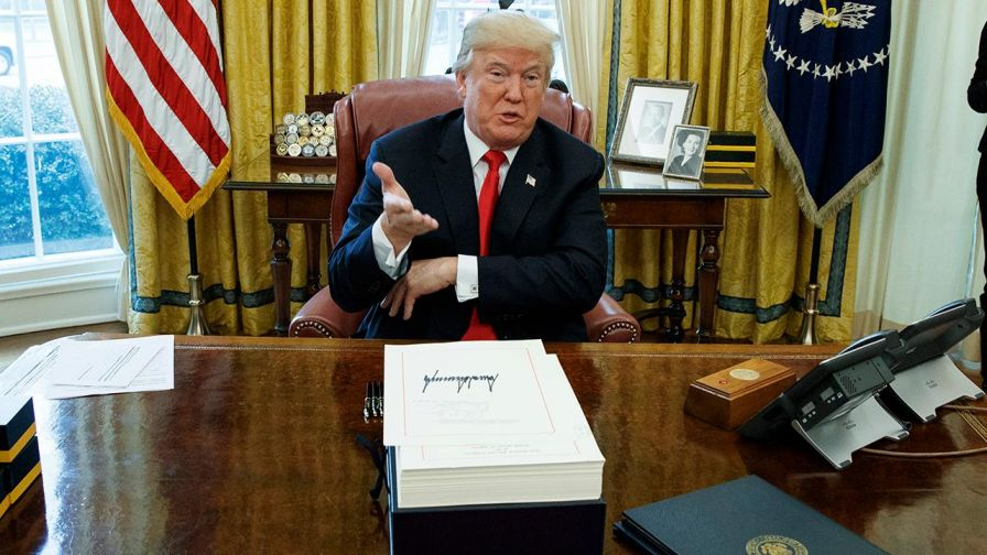 What does the president needs to do in 2018 to keep the U.S. economy booming?