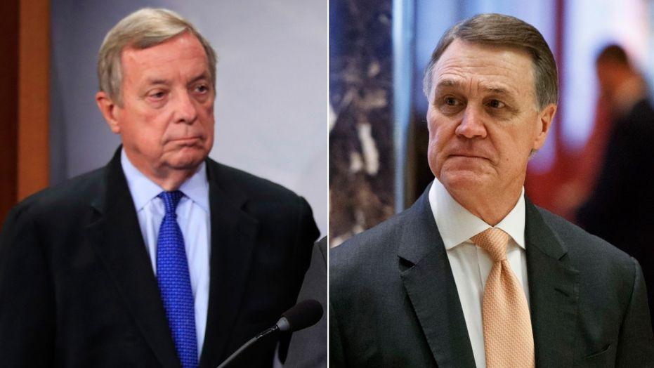 "Sen. David Perdue, right, called Sen. Dick Durbin's description of the Oval Office meeting a ""gross misrepresentation."""