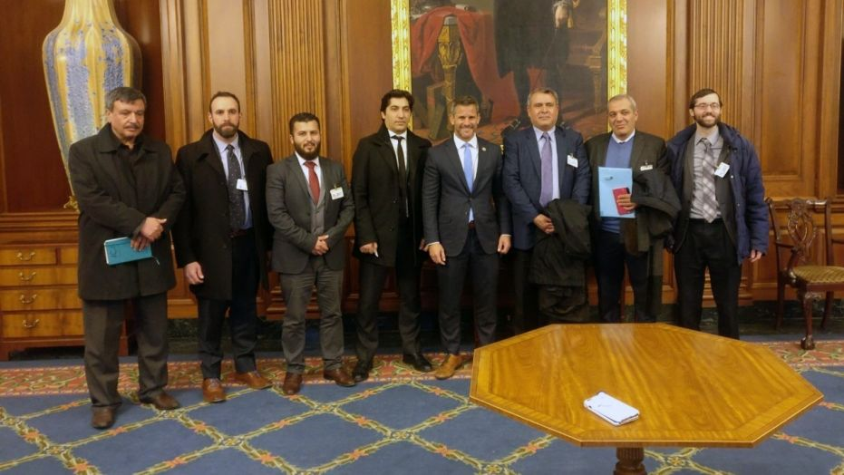Members of the Free Syrian Army delegation pose with Rep. Adam Kinzinger, R-Ill. (fourth from right)