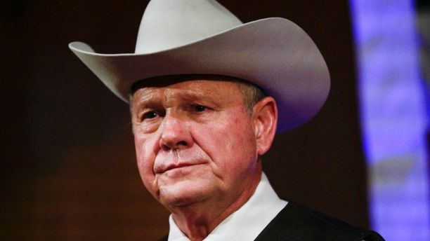 FILE - In this Monday, Sept. 25, 2017, file photo, former Alabama Chief Justice and U.S. Senate candidate Roy Moore speaks at a rally, in Fairhope, Ala. President Donald Trump in tweets Sunday, Nov. 26, is again coming to the side of Moore by bashing the Democratic nominee Doug Jones in the Alabama Senate race. (AP Photo/Brynn Anderson, File)