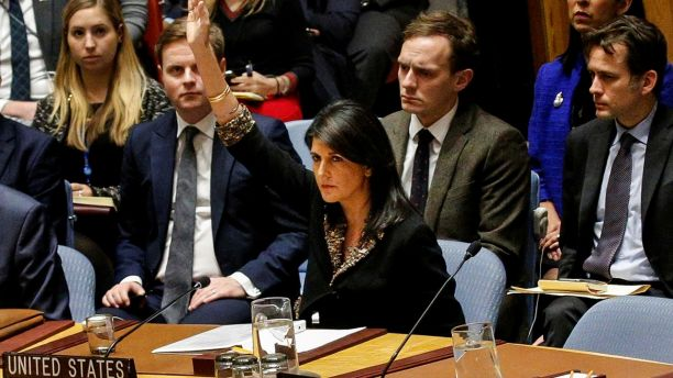 U.S. Ambassador to the United Nations Nikki Haley vetos an Egyptian-drafted resolution regarding recent decisions concerning the status of Jerusalem, during the United Nations Security Council meeting on the situation in the Middle East, including Palestine, at U.N. Headquarters in New York City, New York, U.S., December 18, 2017. REUTERS/Brendan McDermid - RC19707F9890