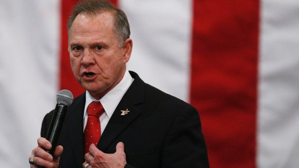 "FILE- In this Dec. 11, 2017, file photo, U.S. Senate candidate Roy Moore speaks at a campaign rally in Midland City, Ala.  Moore is telling supporters ""the battle is not over"" in Alabama's Senate race as he asks for campaign donations and any reports of voting irregularities. Moore in a Friday, Dec. 15, fundraising email asked supporters to contribute to his ""election integrity fund"" and tell them of any problems at the polls. (AP Photo/Brynn Anderson, File)"