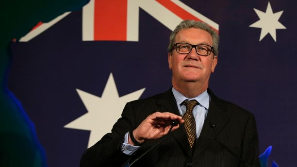 File- This June 22, 2015, file photo shows Australian High Commissioner Alexander Downer, left, speaking to guests during a welcome party at the Australian High Commission in London. Trump campaign adviser George Papadopoulos told the diplomat, Downer, during a meeting in London in May 2016 that Russia had thousands of emails that would embarrass Democratic candidate Hillary Clinton, the report said. Downer, a former foreign minister, is Australia's top diplomat in Britain. Australia passed the information on to the FBI after the Democratic emails were leaked, according to The Times, which cited four current and former U.S. and foreign officials with direct knowledge of the Australians' role. (AP Photo/Alastair Grant, File)