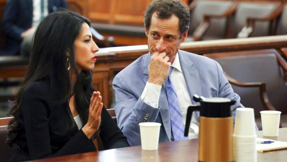 Anthony Weiner, right, and Huma Abedin appear in court in New York on Wednesday, Sept. 13, 2017.