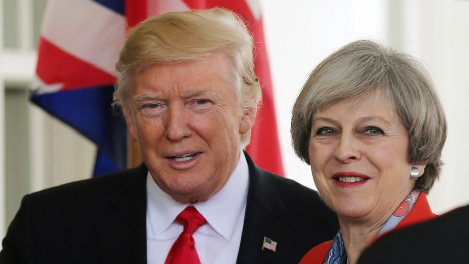 Jan. 27, 2017: U.S. President Donald Trump greets British Prime MinisterTheresa May as she arrives at the White House in Washington.