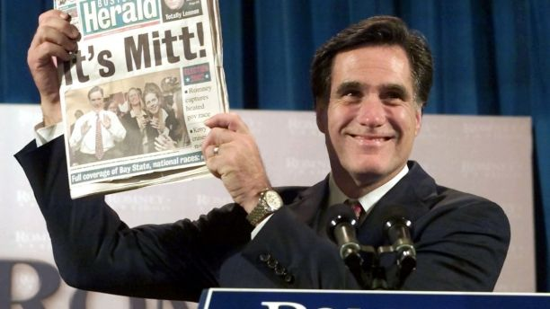 Republican Mitt Romney holds up a Boston newspaper announcing his victory in the Massachusetts Governor's race during his acceptance speech, November 5, 2002 in Boston. Former Salt Lake City 2002 Winter Olympics chief Romney beat [Democratic candidate Shannon O'Brien.] - PBEAHUKOKDZ