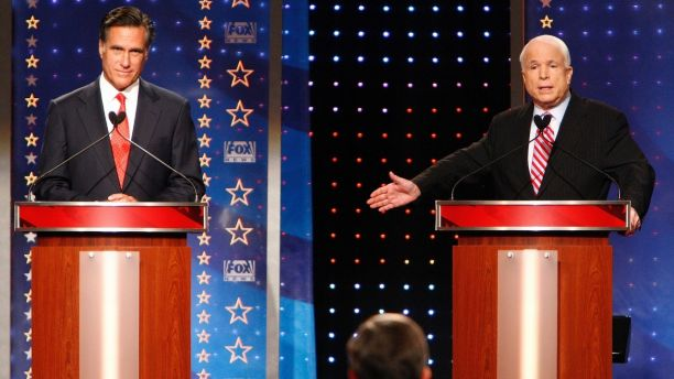 Republican presidential candidates former Massachusetts Governor Mitt Romney (L) and U.S. Sen. John McCain (R-AZ) take part during Fox News Channel Republican Presidential debate at the University of New Hampshire in Durham, New Hampshire, September 5, 2007.   REUTERS/Brian Snyder (UNITED STATES) - GM1DWBZUENAA