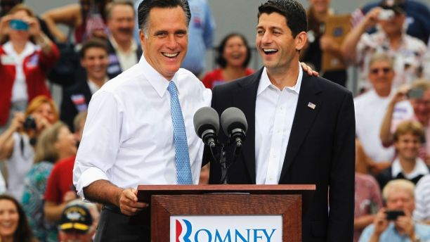 Republican U.S. Presidential candidate Mitt Romney (L) introduces U.S. Congressman Paul Ryan (R-WI) as his vice-presidential running mate during a campaign event at the retired battleship USS Wisconsin in Norfolk, Virginia, August 11, 2012.  REUTERS/Jason Reed (UNITED STATES - Tags: POLITICS ELECTIONS) - GM2E88B1OC701