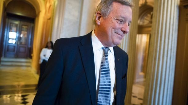Sen. Dick Durbin, D-Ill., the Senate Democratic whip, smiles as he heads for a weekly policy luncheon on Capitol Hill in Washington, Tuesday, Dec. 12, 2017. (AP Photo/J. Scott Applewhite)